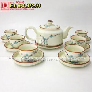 Bộ ấm chén uống trà Bát Tràng men kem vẽ hoa đào