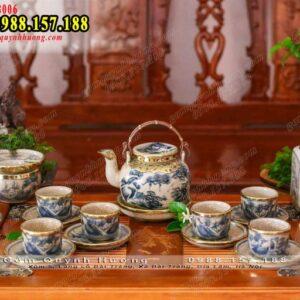 Bộ ấm trà men rạn bọc đồng dáng vung lõm quai đồng